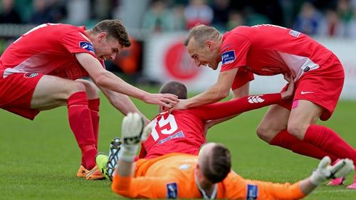 Kael Sheppard and Garry Buckley congratulate Cork goalscorer Danny Morrissey
