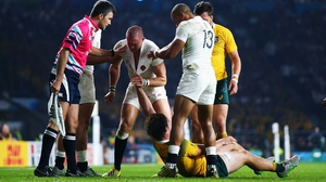 Mike Brown (c) reacts to a dangerous challenge from Australia flanker Michael Hooper