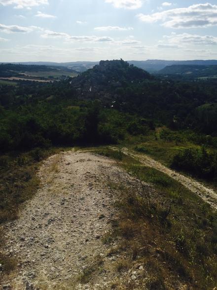 Cordes-sur-Ciel perched on a hilltop in the distance.
