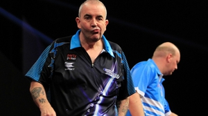 Phil Taylor almost hit a nine-dart finish but his tournament is over (pic: Lawrence Lustig/PDC)