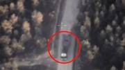 Footage released by the Russian Defence Ministry showing a drone taking aim at what it says is an IS truck