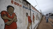 A mural carrying messages about the deadly Ebola virus on a street corner in Monrovia, Liberia