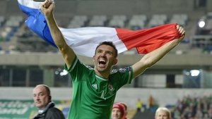 Gareth McAuley celebrates his country's qualification for EURO 2016