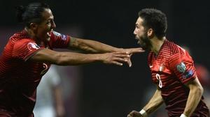Portugal's Joao Moutinho (R) celebrates with Bruno Alves