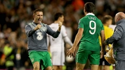 Robbie Keane congratulates Shane Long at the end
