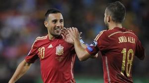 Santi Cazorla celebrates his goal with Jordi Alba