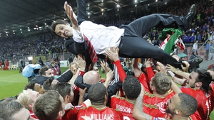 Wales manager Chris Coleman gets the bumps from his team