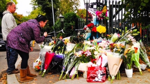 Members of the public pay their respects at the site of the Carrickmines fire