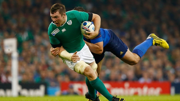 Ireland's Peter O'Mahony barges his way forward against France