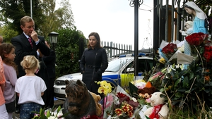 Taoiseach Enda Kenny pays his respects to the victims of the fire