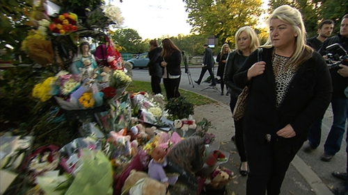 People mourning after the death of 10 people in the Carrickmines fire in 2015. Photo: RTÉ