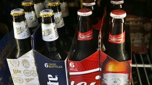 Anheuser-Busch InBev said its core profit in the third quarter fell by 2% to $4.03 billion