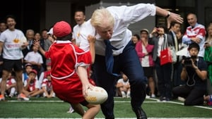 The British Prime Minister dabbles with the oval ball from time to time