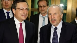 ECB chief Mario Draghi and governing council member Ewald Nowotny