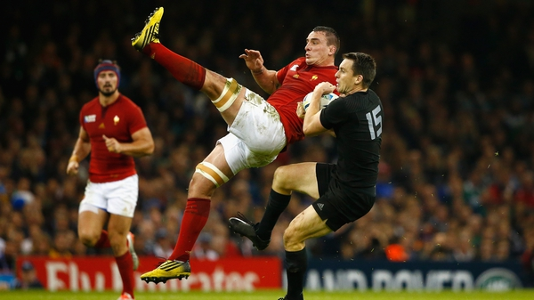 New Zealand full-back Ben Smith goes for a high ball with France's Louis Picamoles