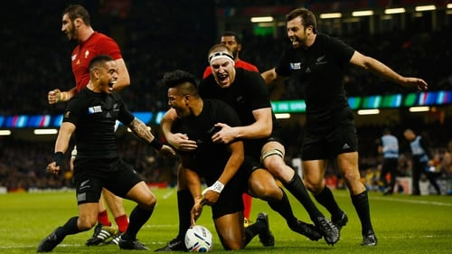New Zealand players celebrate another Julian Savea try