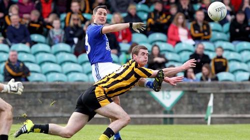 Brendan McDyer gets a shot away despite the efforts of Caolan Ward of St Eunan's