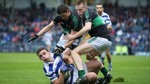 Castlehaven's Mark Collins comes under pressure from Colin O'Brien and Alan O'Donovan