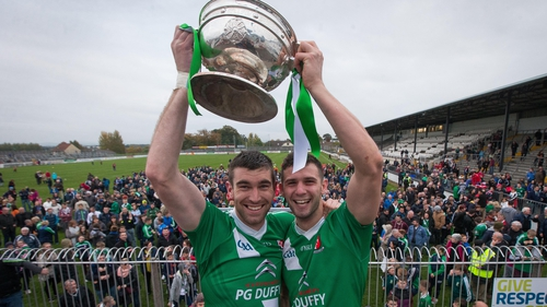 Sarsfields' Sean Campbell and Matty Byrne lift the trophy