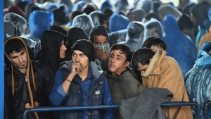 Migrants queue at a border crossing between slovenia and Croatia