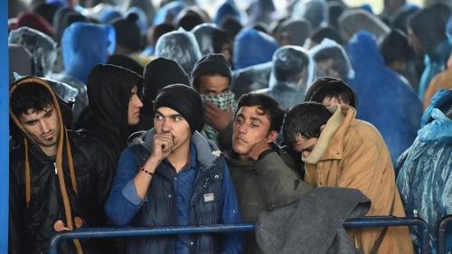 Migrants queue at a border crossing between slovenia and Croatia