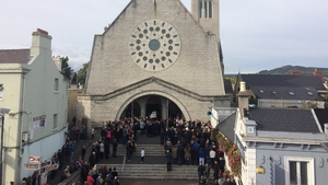 The funeral Mass was held at the Church of the Most Holy Redeemer in Bray