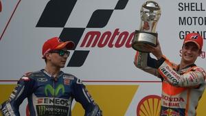 Dani Pedrosa celebrates on the podium after his victory