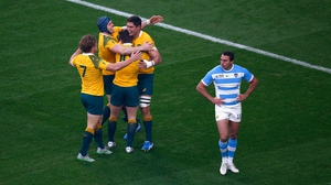 Rob Simmons of Australia celebrates scoring the opening try with team mates as Juan Imhoff of Argentina looks on