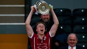 Clara captain Keith Hogan lifts the cup