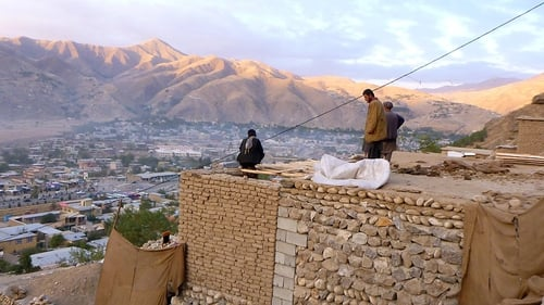 Afghan householders gather on the roof of a house Faizabad in Badakhshan Province