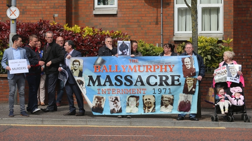 Protesters highlight the killing of ten people in three days of shooting in Ballymurphy, Belfast in 1971