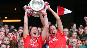 Gemma O'Connor and Orla Cotter lift the O'Duffy Cup at Croke Park
