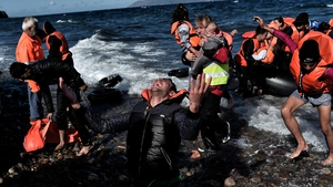 A man reacts as he arrives, with other refugees and migrants on  Lesbos after crossing the Aegean sea from Turkey