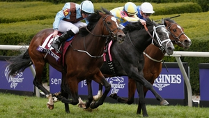 Jockey Ryan Moore rides Hit It A Bomb (L) to edge out Airoforce and Birchwood