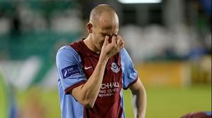 Drogheda's Alan Byrne shows his dejection following Premier League relegation