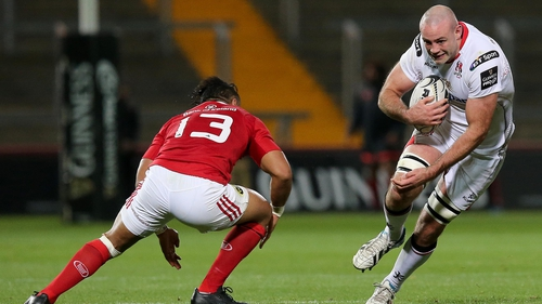 Munster's Francis Saili gets ready to put in another bit on tackle Ulster's Lewis Stevenson