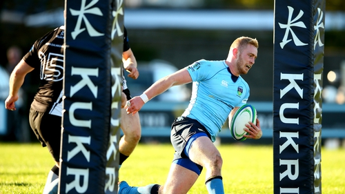 Conall Doherty scores UCD's opening try