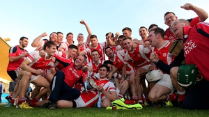 Cuala players celebrate a long overdue victory for the club
