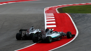 The Mercedes of Lewis Hamilton and Nico Rosberg touch wheels at the first turn in Austin
