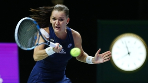Agnieszka Radwanska held firm to take a rollercoaster match