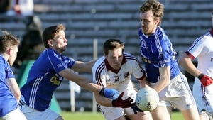 Scotstown's Fergal McPhilips and Damien Mc Ardle with Slaughtneil's Cormac Doherty