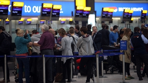 Passengers in Heathrow Airport as thick fog disrupts flights for a second day