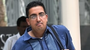 Yogvitam Pravin Dhokia arrives at the state court in Singapore