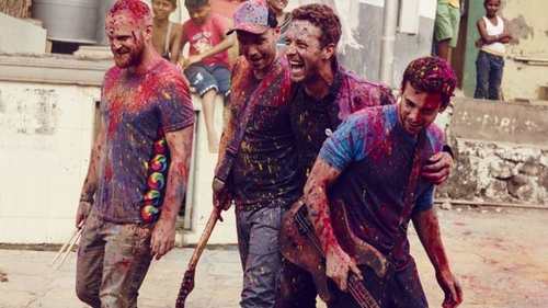 Coldplay painting the town red and purple