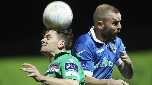 Damien McNulty and Lee Lynch battle for possession