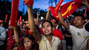 Supporters of Aung San Suu Kyi's National League for Democracy celebrate in the street