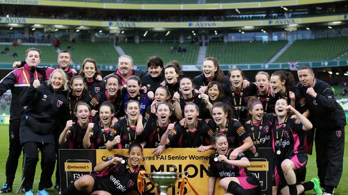 The players and staff of Wexford Youths Women celebrate their dramatic victory