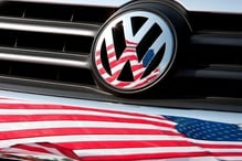 The company and a lawyer for VW brand dealers announced a tentative settlement at a court hearing in San Francisco