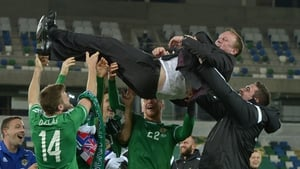 Northern Ireland players showing their appreciation for Michael O'Neill after securing Euro 2016 qualification