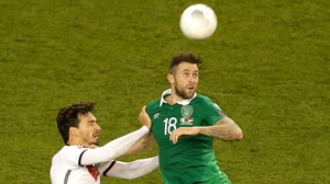 Daryl Murphy battles with Mats Hummels during Ireland's 1-0 victory at the Aviva Stadium